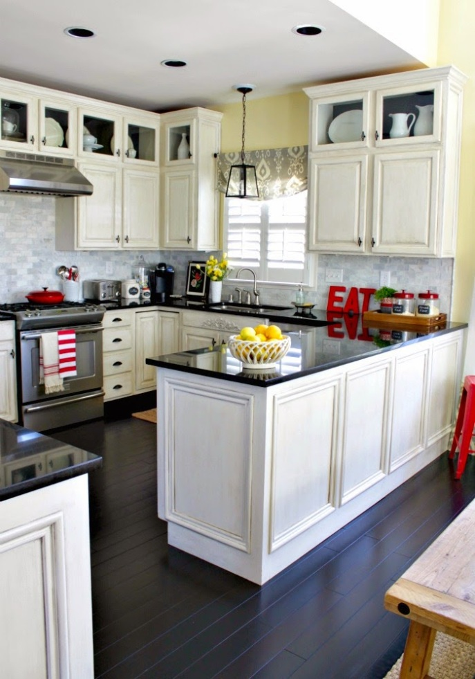 white cabinets - black granite counters - marble backsplash