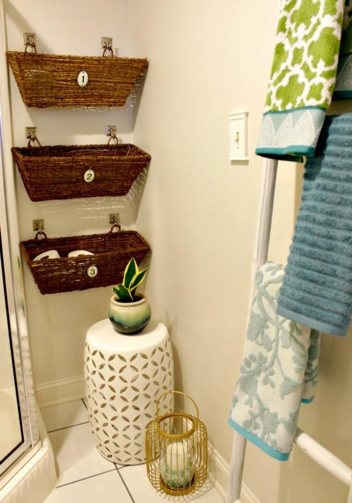 bathroom storage idea - window boxes on hooks