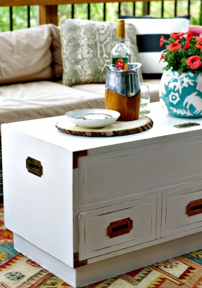 screened porch - madeover campaign trunk as coffee table