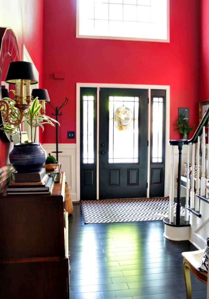 two story entry foyer - bold color - black door - dark floors