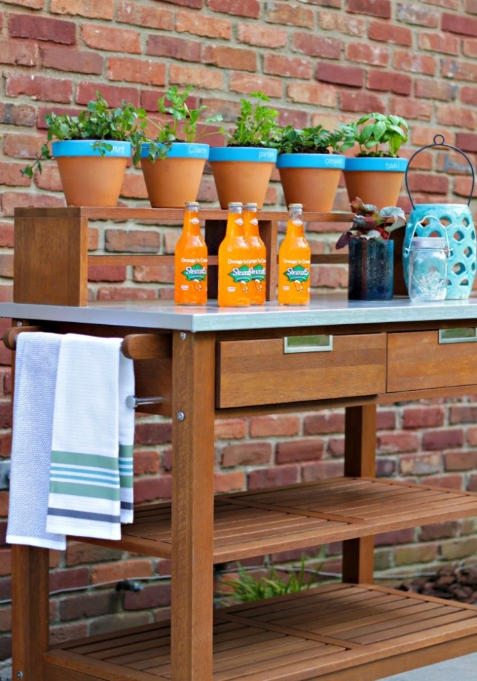 perfect addition to an outdoor dining space  - an outdoor bar cart/plant cart