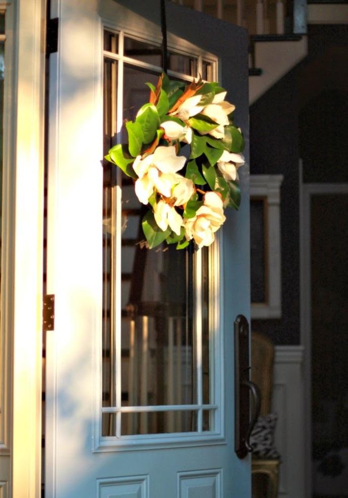 blue front door  - magnolia wreath