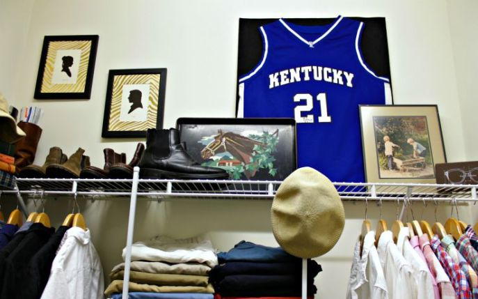 mens closet organization - use tall out of reach areas for out of season storage and for displaying decorative things