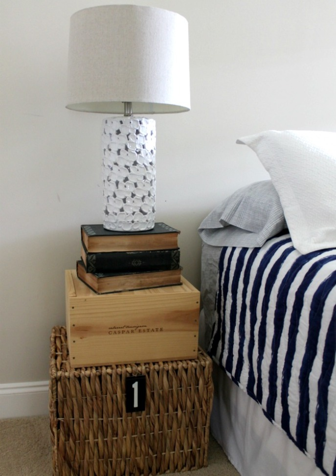 makeshift nightstand - basket, wooden box and books