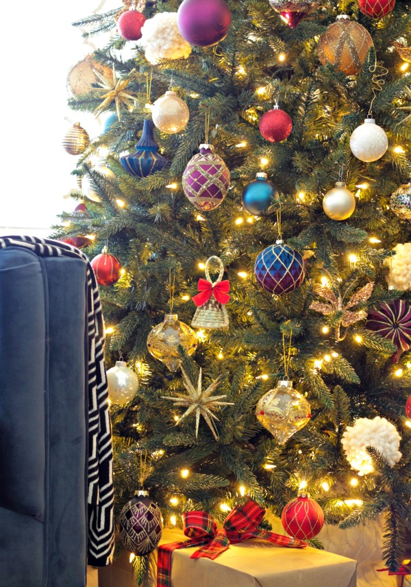 classic Christmas tree decorated with jewel tones