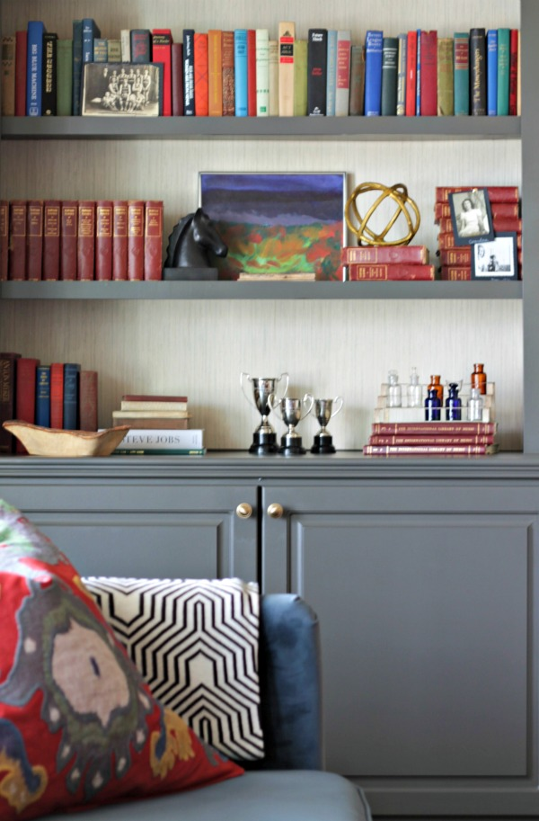 Charcoal grey (Sherwin Williams Urbane Bronze) + Grasscloth on bookcases