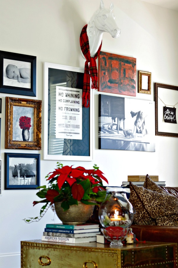 living room gallery wall - decorated for Christmas simply by adding a scarf to horse head