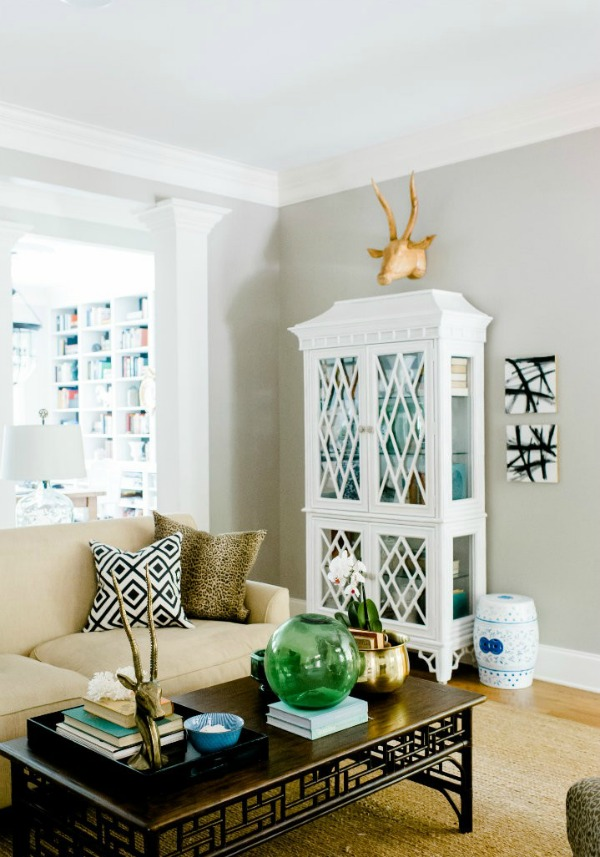 decorating above a cabinet - hang something sculptural - via Emily A Clark